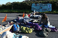 Pictured: Some of the climate protesters who have blocked access to the Valero refinery in Pembroke Dock, Wales, UK. Thursday 19 September 2019<br /> Re: Ten Extinction Rebellion climate change protesters have blocked three entrances of the Valero site in Pembroke Dock, Pembrokeshire, one of the biggest oil refineries in Europe.<br /> Protesters have attached themselves to wooden boxes filled with concrete in a bit to stop vehicles from entering or leaving the site.