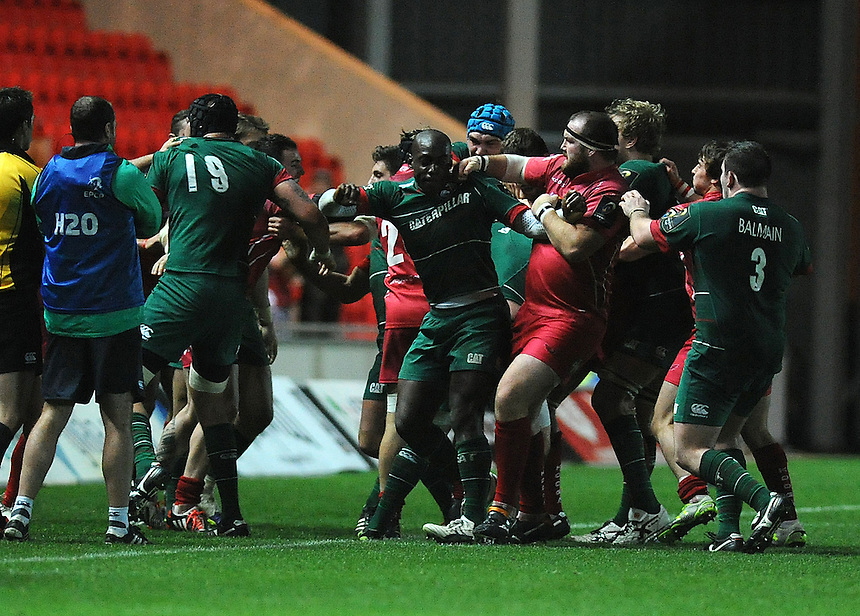 Scarlets' Phil John  punches Leicester Tigers' Miles Benjamin <br /> <br /> Photographer Ashley Crowden/CameraSport<br /> <br /> Rugby Union - European Rugby Champions Cup - Pool 3 - Scarlets v Leicester Tigers - Saturday 25th October 2014 - Parc y Scarlets - Llanelli, Wales<br /> <br /> &copy; CameraSport - 43 Linden Ave. Countesthorpe. Leicester. England. LE8 5PG - Tel: +44 (0) 116 277 4147 - admin@camerasport.com - www.camerasport.com