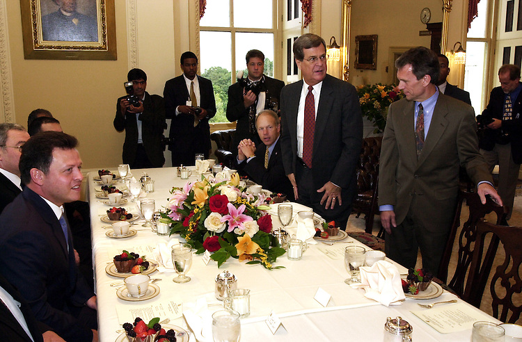 1abdullah092701 -- Jordan's King Abdullah II (left) watches as Trent Lott, R-Miss., and Tom Daschle, D-S.D., take there seats during a luncheon to discuss the coalition forming to fight terrorism.