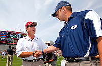 TALLAHASSEE, FL 9/18/10-FSU-BYU FB10 CH01-Florida State Head Coach Jimbo Fisher, left, greets Brigham Young Head Coach Bronco Mendenhall prior to the game Saturday at Doak Campbell Stadium in Tallahassee. .COLIN HACKLEY PHOTO