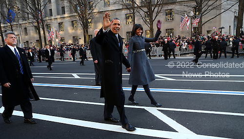 United States President Barack Obama and first lady Michelle Obama take part in the inaugural parade walk down Pennsylvania Ave. towards the White House, in Washington, D.C., Monday  January  21, 2013. .Credit: Doug Mills / Pool via CNP
