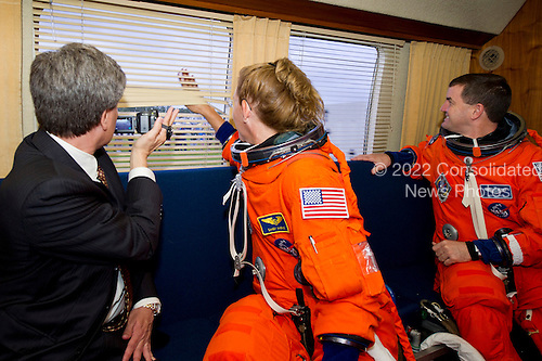 James Branson of United Space Alliance, far left; Sandra Magnus, STS-135 mission specialist and Rex Walheim, STS-135 mission specialist, far right, are seen in the Astrovan as they ride to launch pad 39A to board space shuttle Atlantis on Friday, July 8, 2011, at the Kennedy Space Center in Cape Canaveral, Florida.  The launch of Atlantis, STS-135, is the final flight of the shuttle program, a 12-day mission to the International Space Station.  .Mandatory Credit: Jerry Ross / NASA via CNP