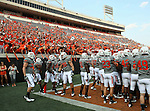 Oklahoma State Cowboys get ready for action during the game between the Louisiana-Lafayette Ragin Cajuns and the Oklahoma State Cowboys at the Boone Pickens Stadium in Stillwater, OK. Oklahoma State defeats Louisiana-Lafayette 61 to 34.