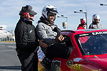 Wake Forest Demon Deacons graduate assistant Stephen Bravo-Brown gets help climbing into a NASCAR race car at the Charlotte Motor Speedway on December 26, 2017 in Concord, North Carolina.  (Brian Westerholt/Sports On Film)