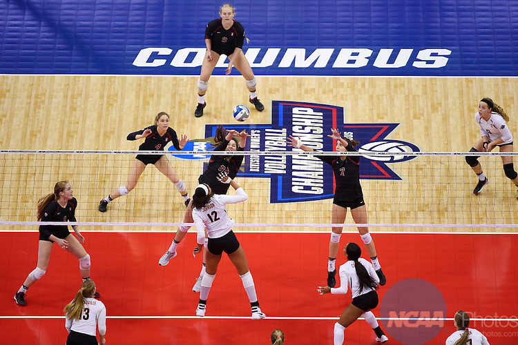 COLUMBUS, OH - DECEMBER 17:  Audriana Fitzmorris (24) of Stanford University jumps for a block against Morgan Johnson (12) of the University of Texas during the Division I Women's Volleyball Championship held at Nationwide Arena on December 17, 2016 in Columbus, Ohio.  Stanford defeated Texas 3-1 to win the national title. (Photo by Jamie Schwaberow/NCAA Photos via Getty Images)