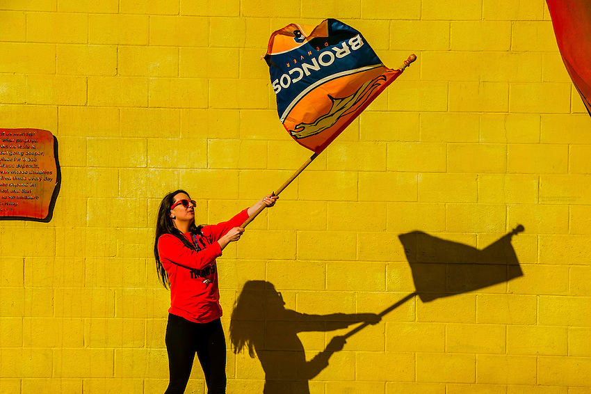 A Denver Broncos fan waves a team flag and shows her team spirit after the team's Super Bowl 50 win, Littleton, Colorado USA.