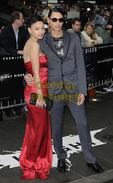 Leah and Natt Weller.'The Dark Knight Rises' European premiere at Odeon Leicester Square cinema, London, England..18th July 2012.full length grey gray suit black dress clutch bag side strapless brother sister siblings family .CAP/CAN.©Can Nguyen/Capital Pictures.