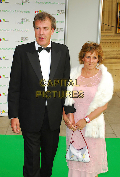 JEREMY CLARKSON & GUEST.At the Dream Auction Full Stop - VIP Party, primarily to launch children's charity NSPCC's There4Me online sevice. Held at the Royal Albert Hall, London, UK..May 9th 2006.Ref: CAN.half length tuxedo pink white fur.www.capitalpictures.com.sales@capitalpictures.com.©Capital Pictures