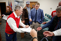 NWA Democrat-Gazette/DAVID GOTTSCHALK Bill Ackerman, chairman Washington County Election Commission, hands out early and absentee results for the general election Tuesday, November 6, 2018, at the Washington County Courthouse in Fayetteville. Results were being collected from 47 Voting Centers in the county.