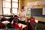 K-8 Parochial School Bronx New York Grade 4 female teacher tallking to girl in class horizontal
