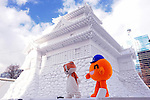 Characters leave the stage during a presentation in front of an ice  sculpture of a Japanese castle during the snow and ice festival in Sapporo City, northern Japan. About 2 million people visit the city to see the hundreds of hand-crafted snow and ice sculptures that have graced the Sapporo Snow Festival since its inception in 1950.