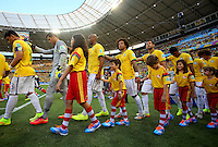 Brazil players walk out before kick off with their hands on each others shoulders