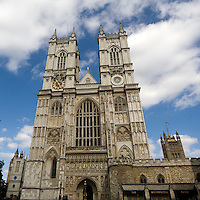 The Collegiate Church of St Peter at Westminster, which is almost always referred to popularly and informally as Westminster Abbey located just to the west of the Palace of Westminster. It is the traditional place of coronation and burial site for English, later British and later still (and currently) monarchs of the Commonwealth Realms.