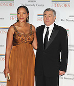 Washington, DC - December 5, 2009 -- Robert De Niro, one of the 2009 Kennedy Center honorees, and his wife, Grace Hightower, arrive for the formal Artist's Dinner at the United States Department of State in Washington, D.C. on Saturday, December 5, 2009..Credit: Ron Sachs / CNP.(RESTRICTION: NO New York or New Jersey Newspapers or newspapers within a 75 mile radius of New York City)