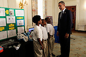 United States President Barack Obama looks at the COOL PADS for shoulders, helmet, armpits and groin created by Evan Jackson, Alec Jackson and Caleb Robinson, from Flippen Elementary School students from McDonough, Georgia, in the State Dining Room of the White House in Washington, D.C. during the White House Science Fair on April 22, 2013. The White House Science Fair celebrates the student winners of a broad range of science, technology, engineering and math (STEM) competitions from across the country. The first White House Science Fair was held in late 2010. <br /> Credit: Aude Guerrucci / Pool via CNP