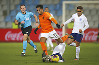 19th November 2019, Stadion De Vijverberg, Doetinchem, Netherlands; U-21 International football freindly, Netherlands versus England;  Netherlands player Justin Kluivert escapes a sliding tackle