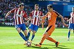 "Atletico de Madrid's Gabriel ""Gabi"" Fernández and Diego Godín and SD Eibar's Kike Garcia during Liga Liga match between Atletico de Madrid and SD Eibar at Vicente Calderon Stadium in Madrid, May 06, 2017. Spain.<br /> (ALTERPHOTOS/BorjaB.Hojas)"