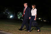 President Donald Trump and First Lady Melania Trump arrive on the South Lawn of the White House on July 16, 2018 in Washington, DC., after a seven-day trip to Europe.<br /> Credit: Oliver Contreras / Pool via CNP