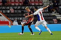 Luka Milivojevic of Crystal Palace tussles with Sam Surridge of Bournemouth during AFC Bournemouth vs Crystal Palace, Carabao Cup Football at the Vitality Stadium on 15th September 2020