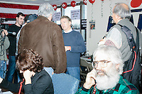 Anthony Nino (green plaid) and daughter Connie Nino (dark hair), of Amherst, NH, call potential voters from the phonebank at the campaign headquarters of Kentucky senator and Republican presidential candidate Rand Paul in Manchester, New Hampshire. At the time, Paul was visiting the office to greet supporters and call voters.