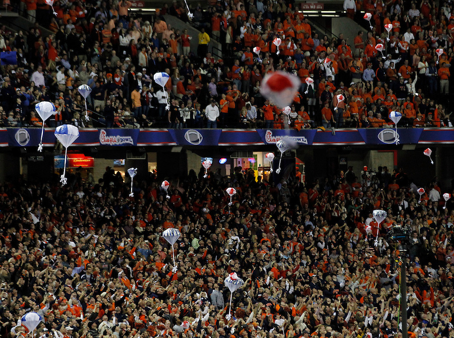 ATLANTA, GA - DECEMBER 31:  Fans cheer as toys parachute from the ceiling at the start of  the 2011 Chick Fil-A Bowl with the Virginia Cavaliers vs. Auburn Tigers at the Georgia Dome on December 31, 2011 in Atlanta, Georgia. Auburn defeated Virginia 43-24. (Photo by Andrew Shurtleff/Getty Images) *** Local Caption ***