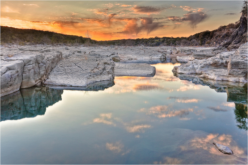Looking over a pool in Pedernales Falls State Park in the heart of the Texas Hill Country, this image shows the winter sky as the sun began to fade. The water was calm and the reflections made for nice Texas Landscape photo.I would have stayed longer, but it was a very cold evening!