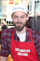 Los Angeles, CA - NOVEMBER 23: Tom Payne, At Los Angeles Mission Thanksgiving Meal For The Homeless At Los Angeles Mission, California on November 23, 2016. Credit: Faye Sadou/MediaPunch
