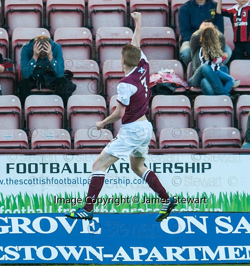 Arbroath's Alan Cook celebrates after he scores their third goal.