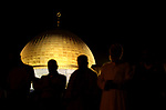 Palestinian Muslim worshipers pray outside the Dome of the Rock in the Al-Aqsa mosques compound in Jerusalem's Old City on the occasion of Laylat al-Qadr, which falls on the 27th day of the fasting month of Ramadan on June 11, 2018. Laylat al-Qadr, or Night of Destiny, marks the night Muslims believe the first verses of the Koran were revealed to the Prophet Mohammed through the archangel Gabriel. Photo by Ayman Ameen