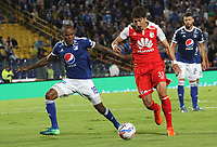 BOGOTÁ - COLOMBIA, 11-11-2018:Jair Palacios (Izq.) jugador de Millonarios disputa el balón conFacundo Guichon (Der.) jugador del Independiente Santa Fe durante partido por la fecha 19 de la Liga Águila II 2018 jugado en el estadio Nemesio Camacho El Campín de la ciudad de Bogotá. /Jair Palacios (L) player of Millonarios  fights for the ball with Facundo Guichon (R) player of Independiente Santa Fe during the match for the date 19 of the Liga Aguila II 2018 played at the Nemesio Camacho El Campin Stadium in Bogota city. Photo: VizzorImage / Felipe Caicedo / Staff.