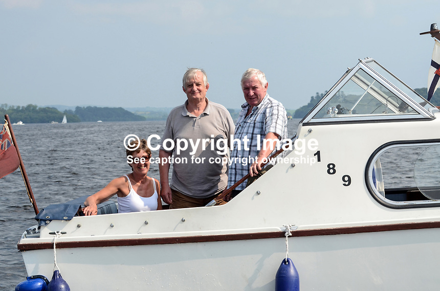 Alan Cooper, onwer, cruiser, Mercador, centre, relaxing with friends, Davy and Diane Clark, on Lough Erne, Co Fermanagh, N Ireland, UK, 20th July 2013, The are all from Enniskillen. 201307202809.   <br />