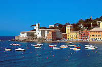 Scenic overview of boats in the harbor n a clear, blue morning along the Italian Riviera. Sestri Levante, Italy.