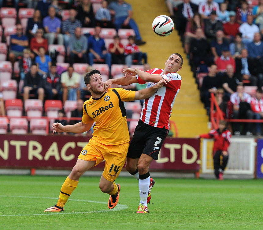 Newport County's Conor Washington battles with Exeter City's Liam Sercombe<br /> <br /> Photo by Ashley Crowden/CameraSport<br /> <br /> Football - The Football League Sky Bet League Two - Exeter City v Newport County - Saturday 21st September 2013 - St James Park - Exeter<br /> <br /> &copy; CameraSport - 43 Linden Ave. Countesthorpe. Leicester. England. LE8 5PG - Tel: +44 (0) 116 277 4147 - admin@camerasport.com - www.camerasport.com
