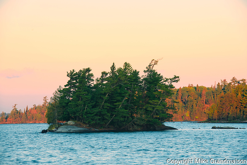 Island and shore of Lake of The Woods at sunrise<br />Sioux Narrows Provincial Park<br />Ontario<br />Canada