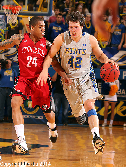 BROOKINGS, SD - MARCH 1:  Jordan Dykstra #42 from South Dakota State University drives against Karim Rowson #24 from the University of South Dakota in the first half or their game Saturday afternoon at Frost Arena in Brookings. (Photo by Dave Eggen/Inertia)