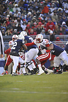 23 November 2013:  Nebraska DE Randy Gregory (44). fights off a block and tackles Penn State RB. The Nebraska Cornhuskers defeated the Penn State Nittany Lions 23-20 in overtime at Beaver Stadium in State College, PA.