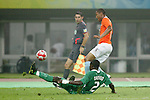 07 August 2008: Chibuzor Okonkwo (NGA) (2) loses his footing as he defends Jonathan De Guzman (NED) (right).  The men's Olympic team of the Netherlands played the men's Olympic soccer team of Nigeria at Tianjin Olympic Center Stadium in Tianjin, China in a Group B round-robin match in the Men's Olympic Football competition.