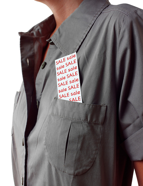 Close up of young women wearing a dress with a  ticket tucked into its pocket with the word sale on it