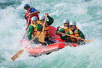 A group enjoys the rapids of the Buller Gorge with Wild River Rafting.