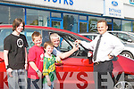SCRUFFY: Stephen Benner of Kerry Motor Works, Mile Height, Tralee, presented the keys of a brand new S Max Ford Car to Sean Finucane of Tarbert, in conjunction with the Gerry Ryan Radio Show, as Sean had the scruffiest car in Ireland. Looking on were Sean's son's Chris, Sean (Jnr) and Matthew Finucane..