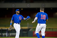 AZL Cubs second baseman Delvin Zinn (21) gives first baseman Luis Hidalgo (18) his hat and glove between innings during the game against the AZL White Sox on August 13, 2017 at Sloan Park in Mesa, Arizona. AZL White Sox defeated the AZL Cubs 7-4. (Zachary Lucy/Four Seam Images)