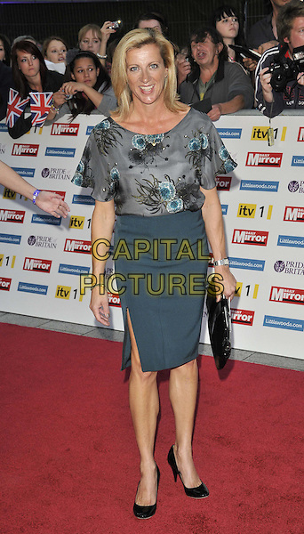 Sally Gunnell.'The Daily Mirror's Pride Of Britain Awards 2011' at Grosvenor House Hotel, London, England..3rd October 2011.full length top skirt grey gray blue print black clutch bag split slit .CAP/CAN.©Can Nguyen/Capital Pictures.