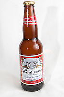 A Budweiser beer bottle over a white background