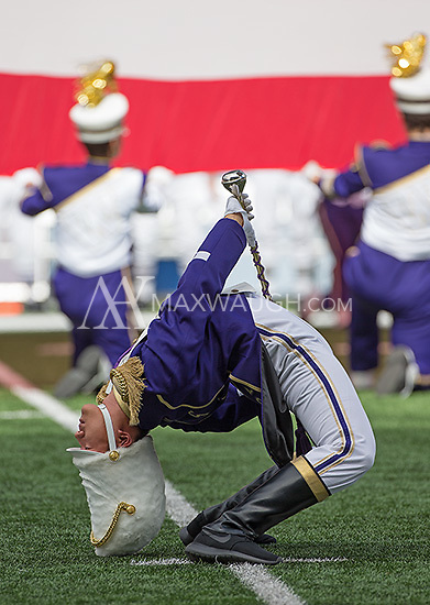 Drum major Brian Huynh performs the traditional back bend during the national anthem.