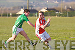 Rathmores Donal O'Sullivan tries to avoid the attentions of Milltown/Castlemaines Shane Murphy during their County league clash in Milltown on Saturday evening...