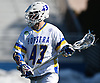 Ryan Tierney #43 of Hofstra University carries behind the net during an NCAA Division I men's lacrosse game against Monmouth at Shuart Stadium in Hempstead, NY on Saturday, Feb. 18, 2017. Tierney, a freshman and 2016 All-American at Massapequa High School, scored three times in his collegiate debut. Hofstra won 11-9.