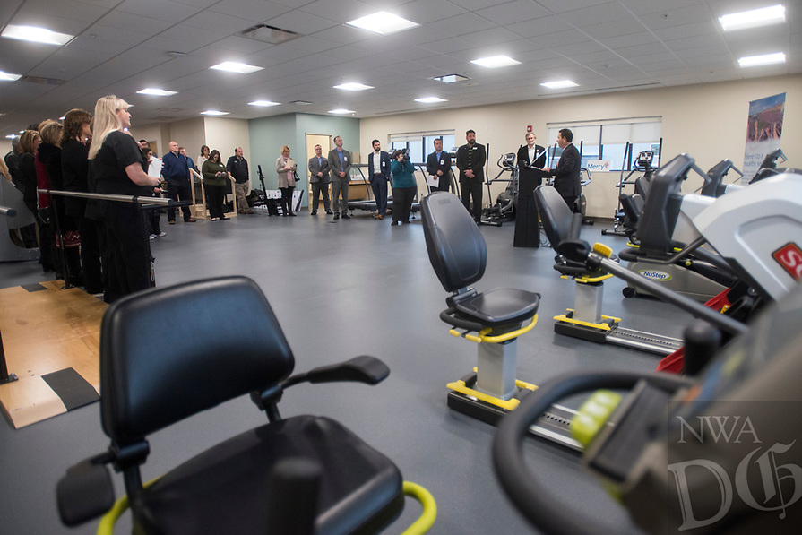 NWA Democrat-Gazette/BEN GOFF @NWABENGOFF<br /> Staff and guests listen as Eric Pianalto, Mercy Hospital Northwest Arkansas president, speaks Wednesday, Feb. 21, 2018, during a ribbon cutting and blessing at Mercy Therapy Services on Horsebarn Road in Rogers. Mercy celebrated the renovation of the facility, quadrupling the space to 10,000 square feet, with more open exercise space, new equipment and curtained-off individual treatment rooms.