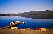 Paddle boats along the Lake Te Anau foreshore await tourists.