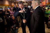 Senator Scott Brown (R-MA) helps policeman Robbie Tusino of Milford with a microphone before speaking at a meeting of the Law Enforcement Coalition for Brown at Johnny Jack's Restaurant in Milford, Massachusetts, USA, on Thurs., Nov. 2, 2012. Senator Scott Brown is seeking re-election to the Senate.  His opponent is Elizabeth Warren, a democrat.