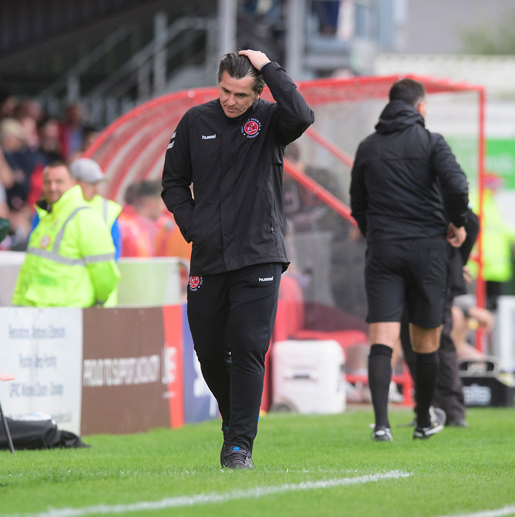 Fleetwood Town manager Joey Barton reacts after a decision went against his side<br /> <br /> Photographer Chris Vaughan/CameraSport<br /> <br /> The EFL Sky Bet League One - Lincoln City v Fleetwood Town - Saturday 31st August 2019 - Sincil Bank - Lincoln<br /> <br /> World Copyright © 2019 CameraSport. All rights reserved. 43 Linden Ave. Countesthorpe. Leicester. England. LE8 5PG - Tel: +44 (0) 116 277 4147 - admin@camerasport.com - www.camerasport.com